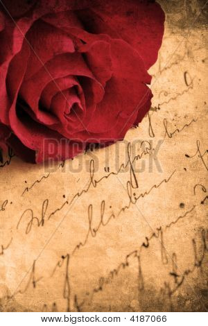Retro look of beautiful red rose and love letter poster