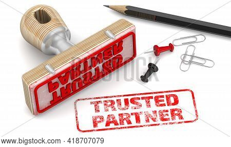 Trusted Partner. The Stamp And An Imprint. Wooden Stamp And Red Imprint Trusted Partner On White Sur
