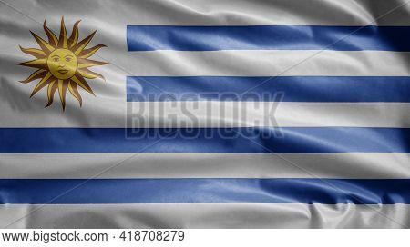 Uruguayan Flag Waving In The Wind. Close Up Of Uruguay Banner Blowing Soft Silk.
