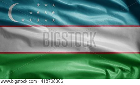 Uzbekistan Flag Waving In The Wind. Uzbek Banner Blowing Soft Silk.