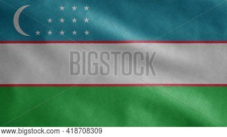 Uzbekistan Flag Waving In The Wind. Close Up Of Uzbek Banner Blowing Soft Silk.