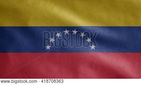 Venezuelan Flag Waving In The Wind. Close Up Venezuela Banner Blowing Soft Silk.