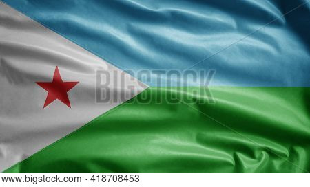 Djiboutian Flag Waving In The Wind. Close Up Djibouti Banner Blowing Soft Silk.
