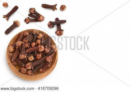 Dry Cloves In Wooden Bowl Isolated On White Background. Top View With Copy Space For Your Text. Flat