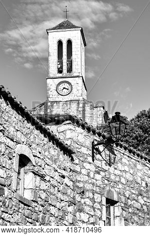 Stone Houses And Belfry With Clock In Village Of Balazuc In France, Monochrome