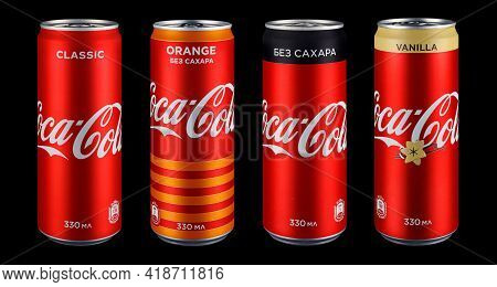Moscow, Russia - April 14, 2021: Set Of Four Coca-cola Red Aluminum Cans With Different Flavors In A