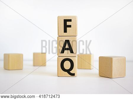 Faq, Frequently Asked Questions Symbol. The Word 'faq, Frequently Asked Questions' On Wooden Cubes O