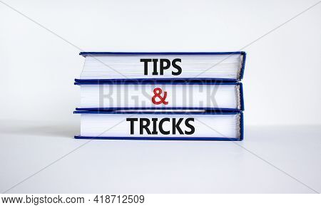 Tips And Tricks Symbol. Books With Words 'tips And Tricks'. Beautiful White Background. Business And