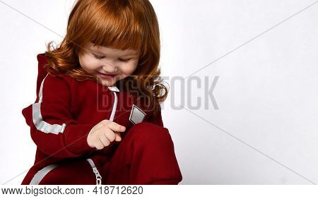 Shy Young Red-haired Girl Looking At The Floor
