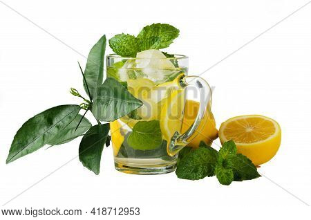Non-alcoholic Refreshing Drink With Lemon, Mint Leaves And Ice Cubes. Isolated On A White Background