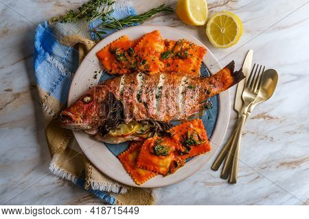 Whole Head-on Red Snapper Seafood Dinner With Ravioli In Sherry Wine Pink Sauce