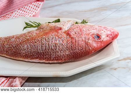 Fresh Whole Raw Head-on Red Snapper Stuffed Seasoned And Ready To Be Cooked