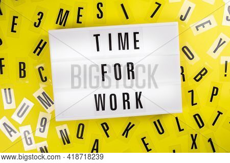 Lightbox With Message Time For Work On Yellow Background With Black Letters Randomly Scattered. Conc