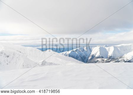 Scenic Panoramic Shot Of Snow-capped Mountains In Zakopane, Poland. Snowy Winter Landscape. Shot Is