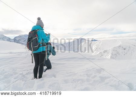 Kasprowy Wierch, Poland 28.01.2021 - Two Mountaineers On The Peak Taking Pictures Of Beautiful Scene