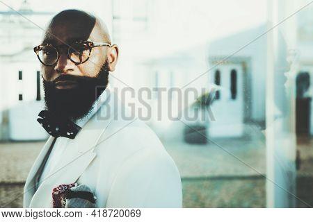 Portrait Of An Elegant Stately Bald Bearded Black Guy In Eyeglasses And A Fashionable White Custom-m