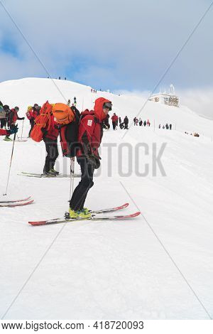 Kasprowy Wierch, Poland 28.01.2021 - Skier Wearing A Backpack On A Snowy Mountain. Group Of Mountain