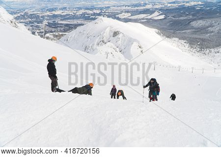 Kasprowy Wierch, Poland 28.01.2021 - Hikers Team On A Snow-covered Mountain. Picturesque Snow-capped