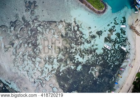 Drone Field Of View Of Boats In Harbour In Turquoise Water La Digue, Seychelles.