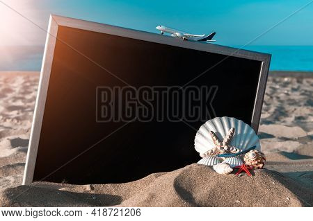 Summer Holidays Background. Starfish, Seashells, Toy Plane And Globe Near Blackboard On Ocean Nature