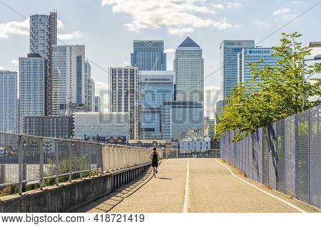 July 2020. London. Man Running And Looking At Canary Wharf, London, England