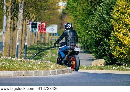 Reims France April 28, 2021 People With A Motorcycle Driving Through The Streets Of Reims During The