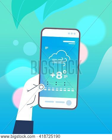 Human Hand Holding Smartphone With Daily Temperature Mobile App Weather Forecasting And Meteorology