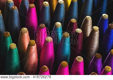 Colorful Cotton Yarn On Spool, Multi-colored Spools For Use In Loom For Weaving In Thailand.