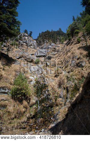 Beautiful Small Waterfall In High Altitude Rocky Mountain In Himachal Pradesh, India