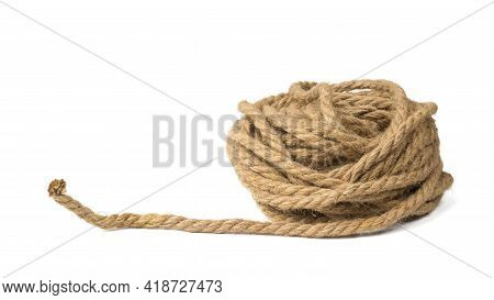 Unwinding Coil Of Strong Rope Isolated On A White Background. Material For Binding Various Products.