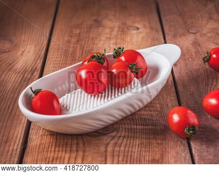 Cherry Tomatoes With Leaves On A Porcelain White Grater Table For Gravy Judgment