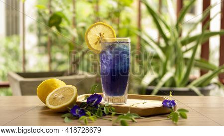 A Glass Of Blue Butterfly Pea Flower Juice Drinking, Decorated With Yellow Lemon Fruit Sliced, Fresh