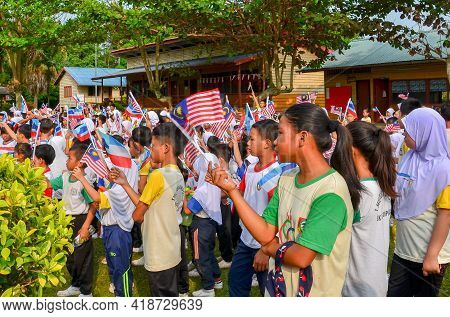 Keningau,sabah,malaysia-aug 29,2014:students With Malaysian And Sabah Flags Marched During The State