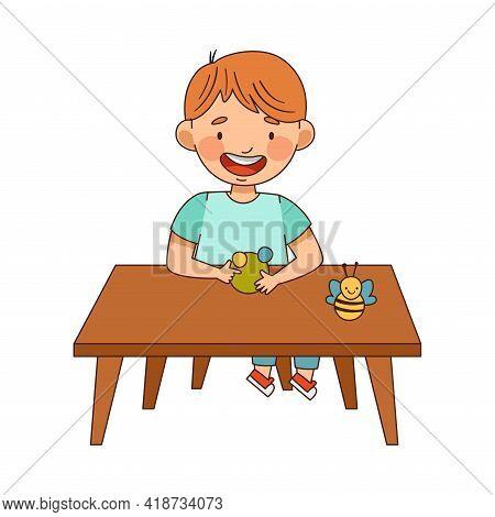 Smiling Boy In Kindergarden Sitting At Desk Modelling From Plasticine Vector Illustration