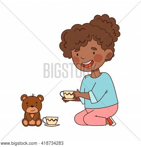 Smiling Little African American Girl In Kindergarden Sitting On The Floor And Playing With Teddy Bea