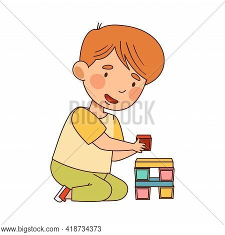 Smiling Little Boy In Kindergarden Sitting On The Floor And Playing Toy Blocks Building Tower Vector