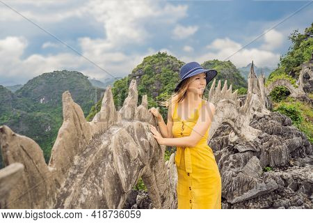 Woman Tourist On Background Of Amazing Huge Dragon Statue At Limestone Mountain Top Near Hang Mua Vi