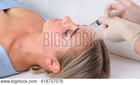 Beautiful Girl Has A Facial Massage In A Beauty Clinic. Facial Skin Care Concept