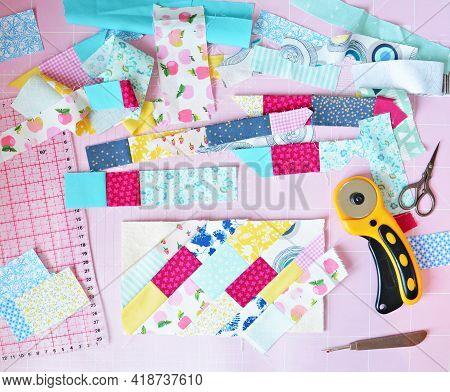 Fabric Scraps, Scissors, Rotary Cutter, Seam Ripper, Quilting Ruler And Cutting Mat