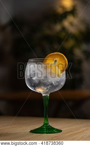 Full Glass Of Fresh Cool Tonic Water With Orange Fruits