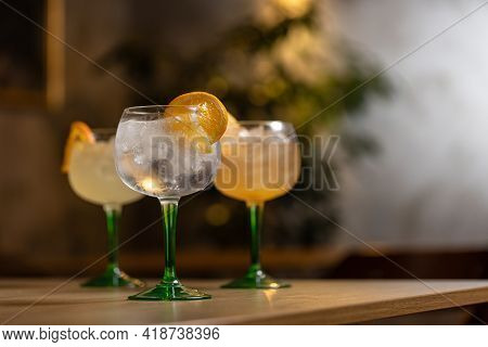 Alcoholic Drink Gin Tonic Cocktail With Orange On Restaurant Table