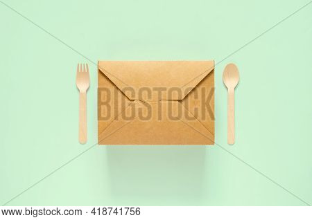 Disposable, Compostable Paper Food Box, Fork And Spoon On Green Background For World Environment Day