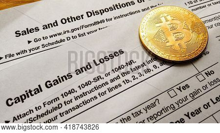Qawra, Malta 27.04.2021 - Cryptocurrency And Capital Gain. Bitcoin Over 8949 Form And Schedule D Of