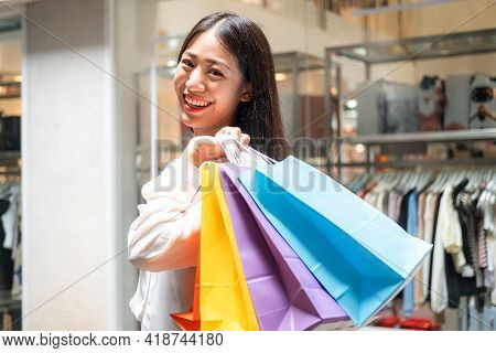 Portrait Of Asian Woman Shopaholic Smiling And Holding With Many Colorful Shopping Bags After Just E