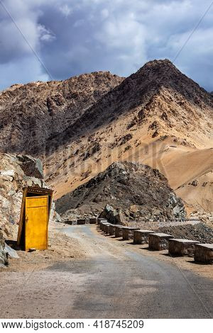 Roadside toilet booth on road in Himalayas. Leh, Ladakh, India