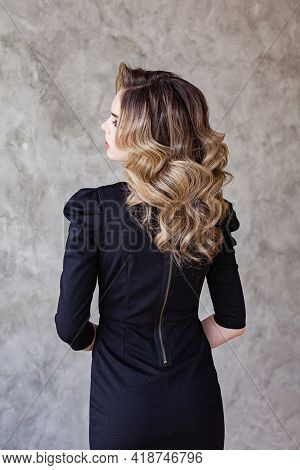 Perfect Woman Back And Head With Curly Hairdo On Gray Background