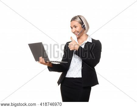 Distance Business. Attractive Adult Smiling Caucasian Woman In Formal Wear With Headset And Micropho
