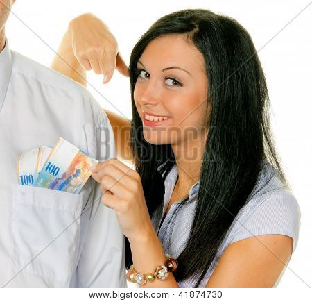 young woman pulls a man out of his pocket swiss francs