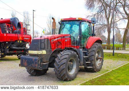Kyiv, Ukraine - August 2, 2020: Case Ih Tractor 225 And Logo At Kyiv, Ukraine On August 2, 2020.