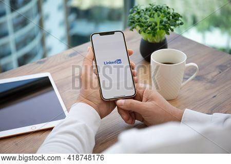 Alanya, Turkey - April 7, 2021: Man Hand Holding Iphone 12 Pro Max Gold And Ipad With App Linkedin I